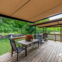 beige-retractable-awning-over-deck