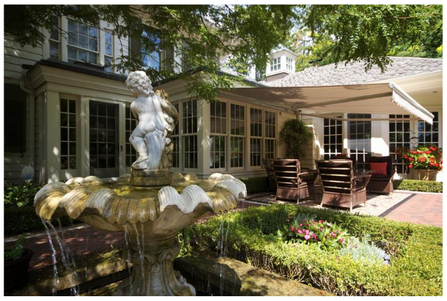 Backyard with Fountain and Retractable Awning